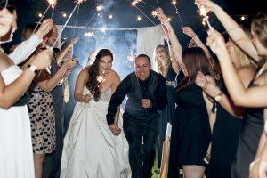 1412102124_07-04-14-wedding-sparklers-bride-and-groom